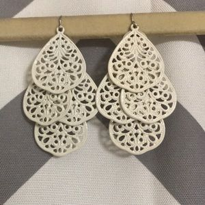 White dangling earrings